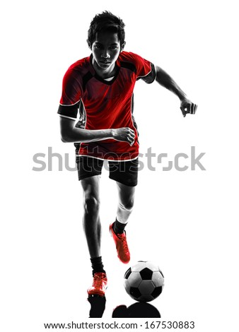 one asian soccer player young man dribbling in silhouette isolated white background - stock photo