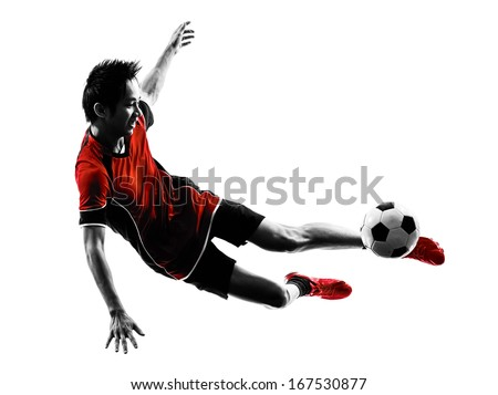 one asian soccer player young man kicking in silhouette isolated white background - stock photo