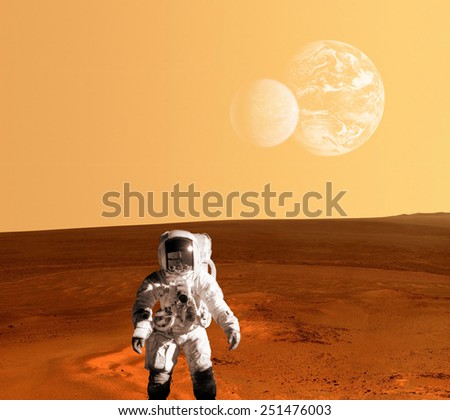 One astronaut spaceman planet Mars surface colony . Elements of this image furnished by NASA. - stock photo