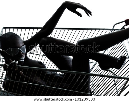 one beautiful black african naked woman sitting inside in a caddy shopping cart in studio isolated on white background - stock photo