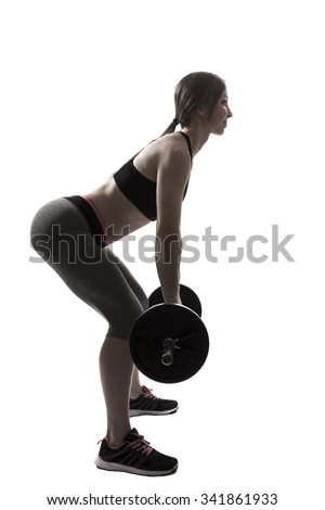one beautiful fitness woman fitness sport exercising deadlift with dumbbells silhouette on white background - stock photo