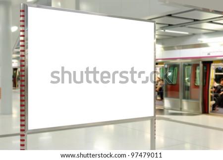 One big horizontal / landscape orientation blank billboard with subway / underground train background - stock photo