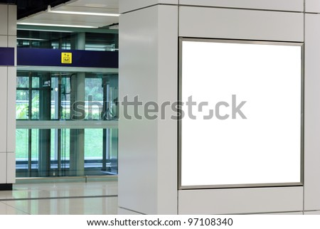 One big square blank billboard on modern white wall with lift background - stock photo