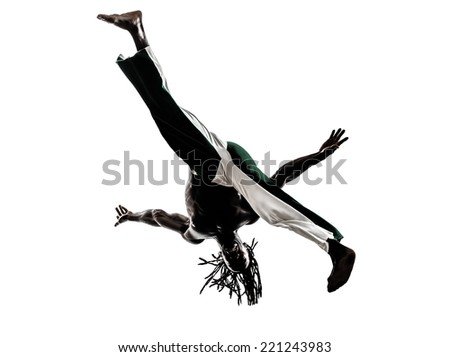 one black man dancer dancing capoeira on white background - stock photo