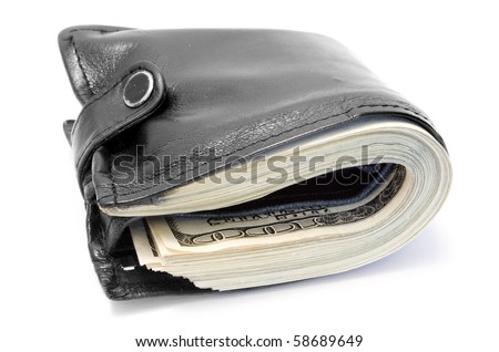 One black purse with the big pack of dollars - stock photo
