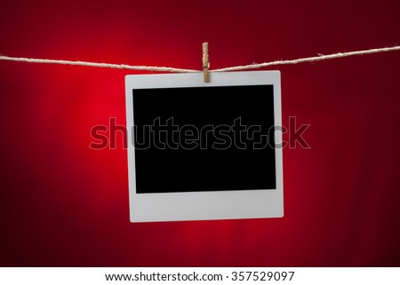 One blank instant photo frame on red background - stock photo