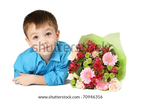 One boy looking up with bouquet of miscellaneous flowers isolated on white background - stock photo