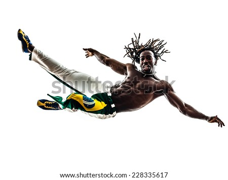 one Brazilian black man jumping dancing capoeira dancer on white background - stock photo