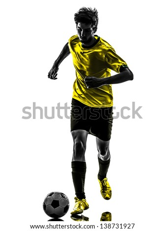one brazilian soccer football player young man in silhouette studio isolated on white background - stock photo