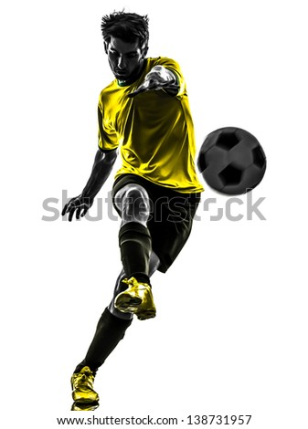 one brazilian soccer football player young man kicking in silhouette studio isolated on white background - stock photo