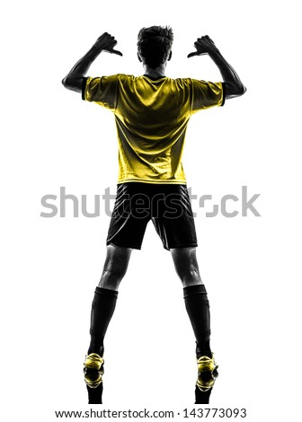 one brazilian soccer football player young man rear view portrait pointing in silhouette studio  on white background - stock photo
