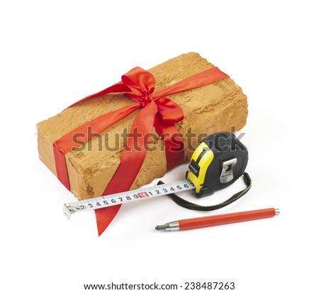 One brick, a ruler, a pencil a white background - stock photo