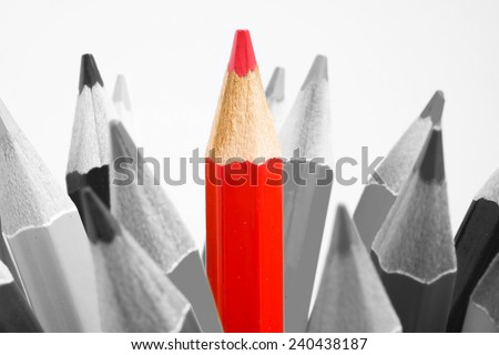 One bright color  pencil among bunch of gray pencils - stock photo