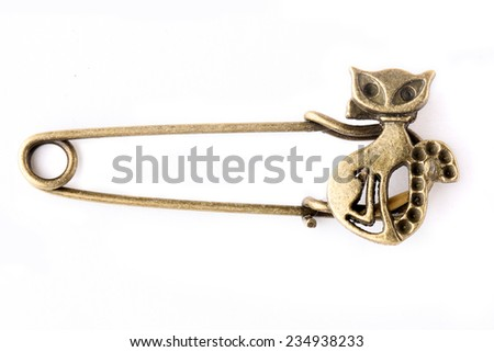 One Bronze safety pin isolated on white background - stock photo
