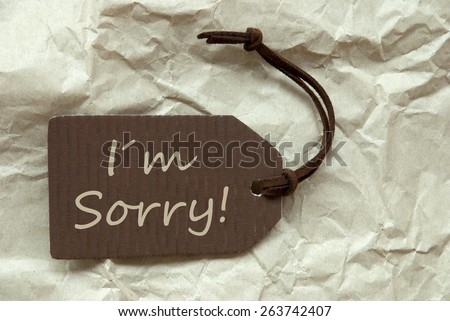 One Brown Label Or Tag With Brown Ribbon On Crumpled Paper Background With English Text I Am Sorry Vintage Or Retro Style - stock photo