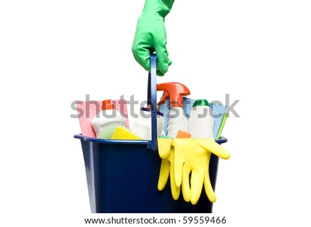 One bucket with cleaning supplies in hand - stock photo