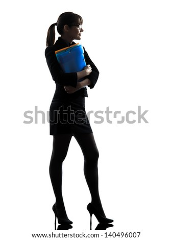 one business woman holding folders files standing  silhouette studio isolated on white background - stock photo