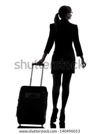one business woman traveler walking  rear view  silhouette studio isolated on white background - stock photo