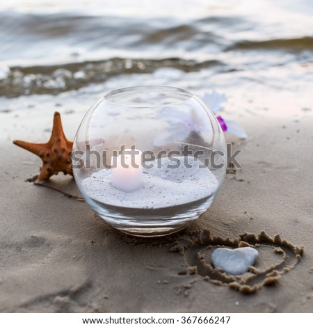 One candle at the sea - stock photo