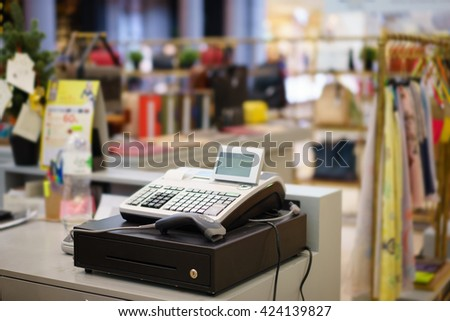 One cash register with a bar code reader in department store - stock photo