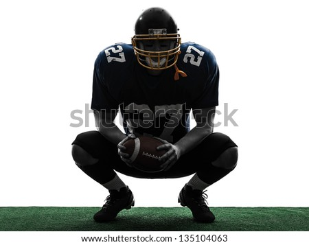 one caucasian american football player man in silhouette studio isolated on white background - stock photo