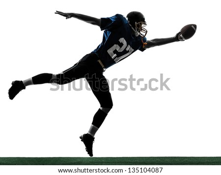 one caucasian american football player man scoring touchdown   in silhouette studio isolated on white background - stock photo