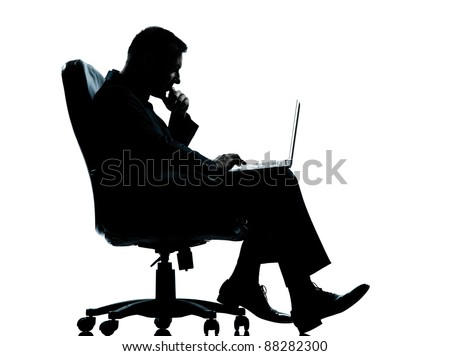 one caucasian business man computer computing sitting in armchair silhouette Full length in studio isolated on white background - stock photo