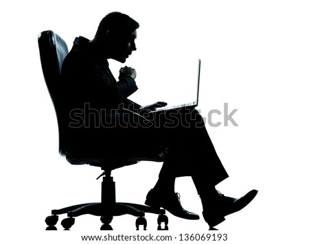 one caucasian business man computer computing surprised sitting in armchair silhouette Full length in studio isolated on white background - stock photo