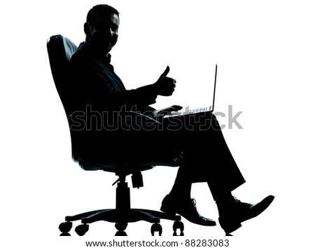 one caucasian business man computer computing thumb up sitting in armchair silhouette Full length in studio isolated on white background - stock photo