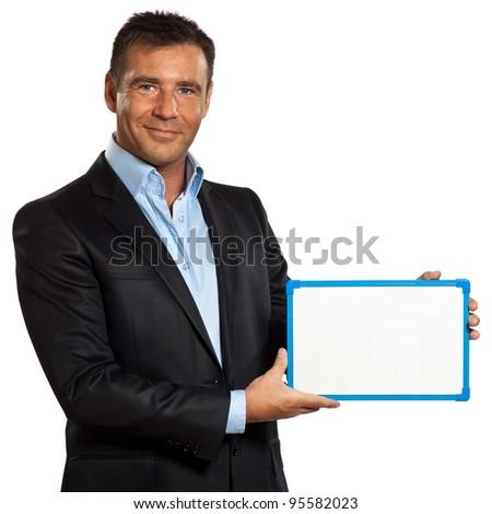 one caucasian business man holding showing whiteboard in studio isolated on white background - stock photo