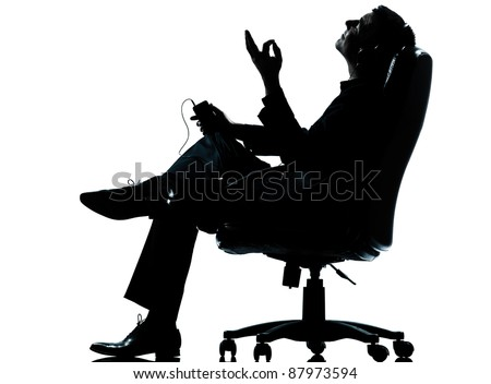one caucasian business man listening music  silhouette Full length in studio isolated on white background - stock photo