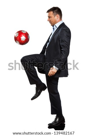 one caucasian business man playing juggling soccer ball in studio isolated on white background - stock photo