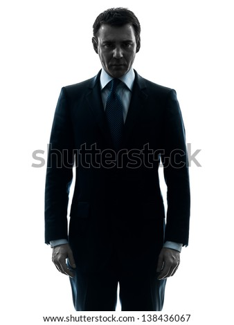 one caucasian business man serious looking at camera  in silhouette studio isolated on white background - stock photo