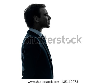 one caucasian business man serious portrait profile   in silhouette studio isolated on white background - stock photo