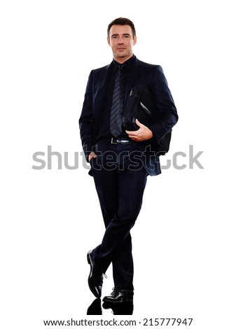 one caucasian business man standing smiling in silhouette on white background - stock photo