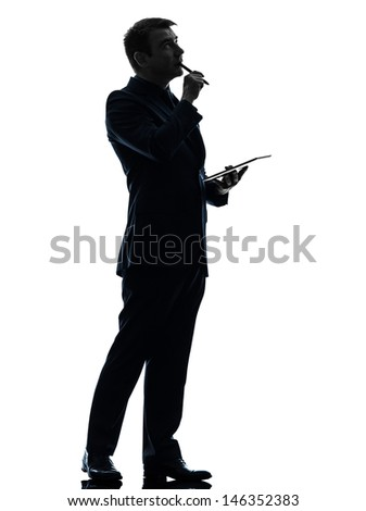 one caucasian business man thinking pensive  holding digital tablet   in silhouette on white background - stock photo