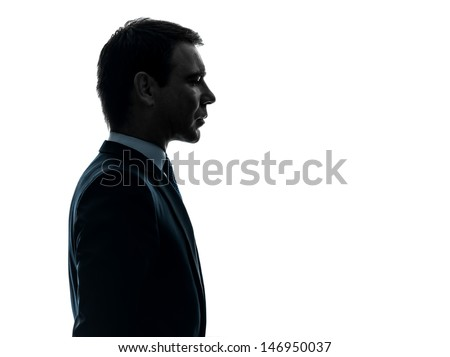 one caucasian business man thinking portrait in silhouette studio isolated on white background - stock photo