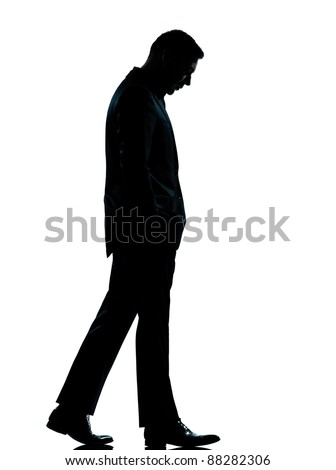 one caucasian business man walking silhouette Full length in studio isolated on white background - stock photo