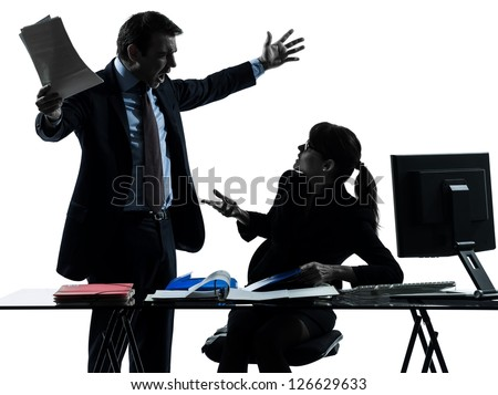 one caucasian business woman man couple dispute conflict  in silhouette studio isolated on white background - stock photo
