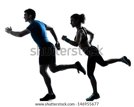 one caucasian couple man woman personal trainer coach runner running jogging sprinting silhouette studio isolated on white background - stock photo
