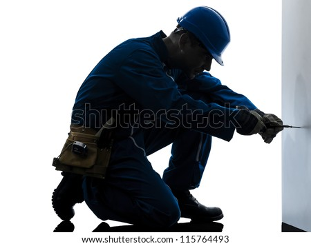one caucasian man construction worker screwdriving silhouette in studio on white background - stock photo