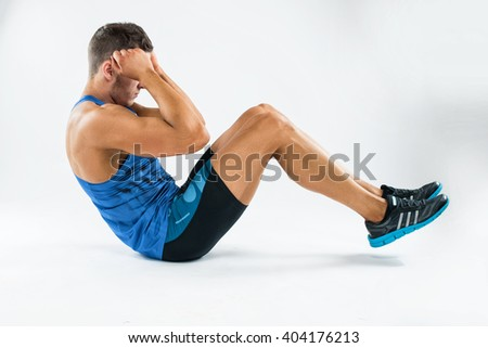 one caucasian man exercising crunches fitness weights exercises in studio.  - stock photo
