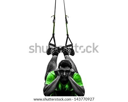 one caucasian man exercising   suspension training  trx tired pouting    on white background - stock photo