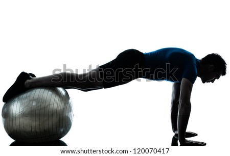 one caucasian man exercising workout fitness ball in silhouette studio  isolated on white background - stock photo