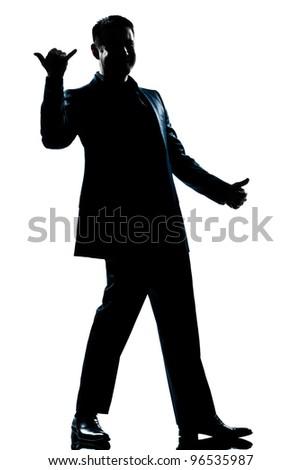 one caucasian man happy saluting shaka sign full length silhouette in studio isolated white background - stock photo