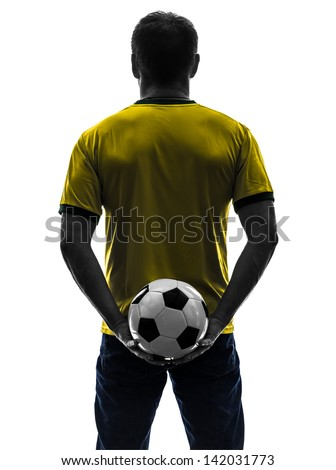 one caucasian man holding soccer football silhouette rear view back  in silhouette on white background - stock photo