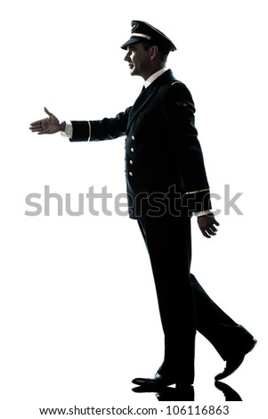 one caucasian man in airline pilot uniform walking handshake silhouette in studio isolated on white background - stock photo