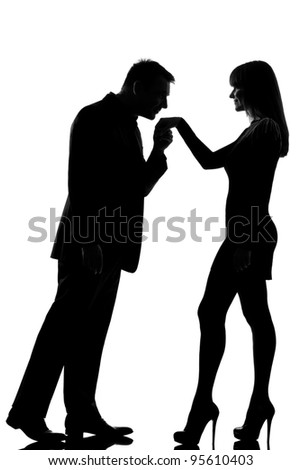 one caucasian man kissing hand woman  in studio silhouette isolated on white background - stock photo