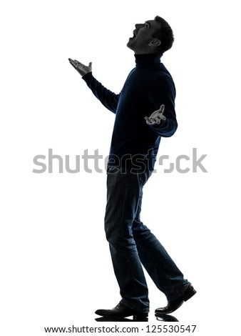 one caucasian man looking up happy  full length in silhouette studio isolated on white background - stock photo
