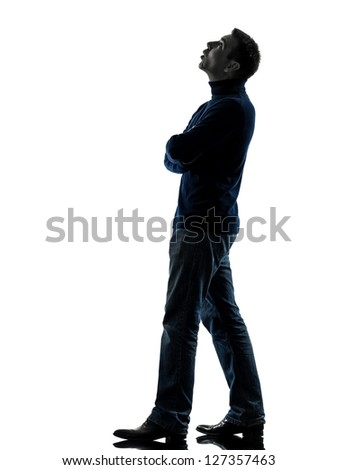 one caucasian man looking up pensive  full length in silhouette studio isolated on white background - stock photo
